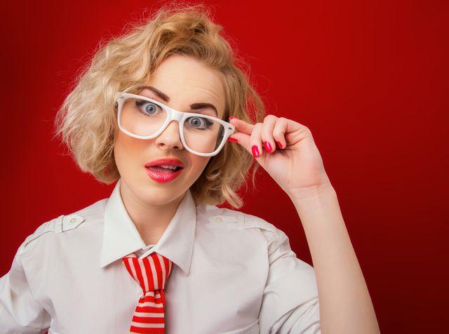 Amazedly woman wearing eyeglasses